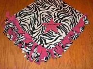 Tied blanket with applique